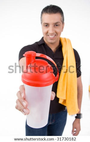 front view of smiling man offering water bottle with white background - stock photo