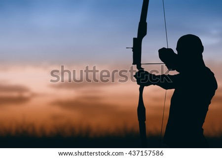 Front view of sportsman is practicing archery against sky and field