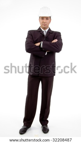 front view of standing architect with crossed arms on an isolated background - stock photo
