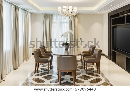 Front View Of Stylish And Light Dining Room With Big Windows And Crystal  Chandelier In Center
