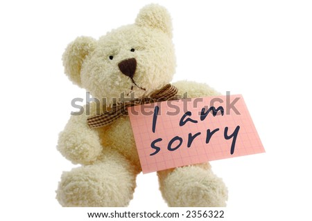"""Front view of teddy bear toy with """"I am sorry"""" note, isolated on white background - stock photo"""
