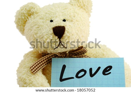 "Front view of teddy bear toy with ""Love"" note, isolated on white background"