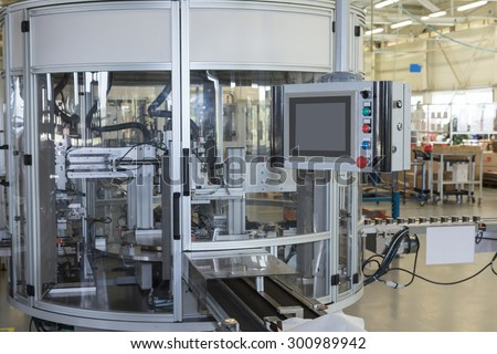 Front view of the automatic production line with a control panel. All potential trademarks are removed. - stock photo