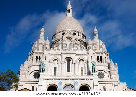 Front view of the Basilica of the Sacred Heart of Paris, one of the most popular landmarks in the city, located in the summit of the butte Montmartre, the highest point in the city. - stock photo