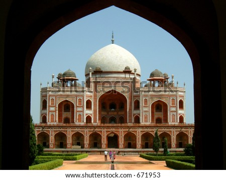 front view of the humayun tomb framed by the fort wall entrance - stock photo