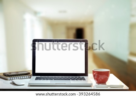 Front view of the laptop and coffee cup is on the work table in meeting room.vintage effect  - stock photo