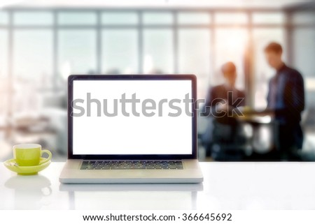 Front view of the laptop is on the work table in meeting room. - stock photo