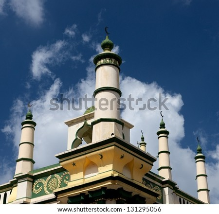 Front view of top of medina and minarets, typical arabic religion building on blue cloudy sky background, arabic, church - stock photo