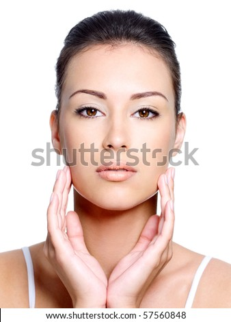 Front view of young beautiful woman's face with healthy fresh clean skin - close-up - stock photo