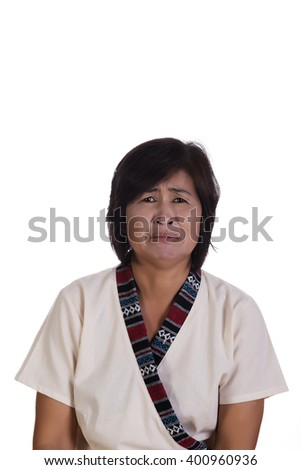 Front view on single frowning middle aged woman with overwhelmingly sad and pouting expression over white background - stock photo