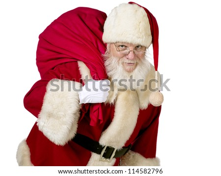Front view portrait of Father Santa Claus with gift bag