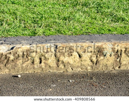 Front View Vignette Sandstone Curb Layers - stock photo