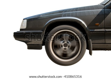 Front vintage car details with spinning wheel on white background,side view - stock photo