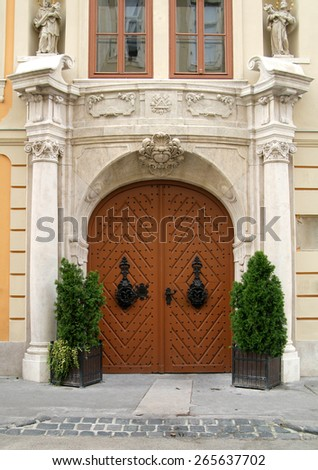 Front wall of old stylish apartment house. - stock photo