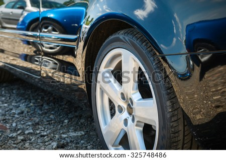 Front wheel details. Side view of the modern car.