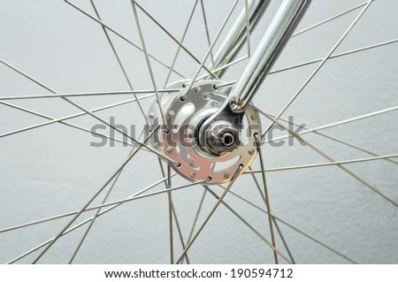 Front wheel of the bike with plaster wall background