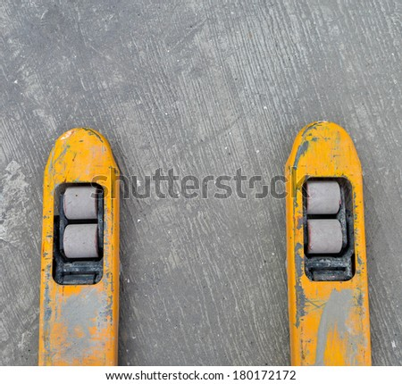 Front Wheels of Hand Pallet power jack - stock photo