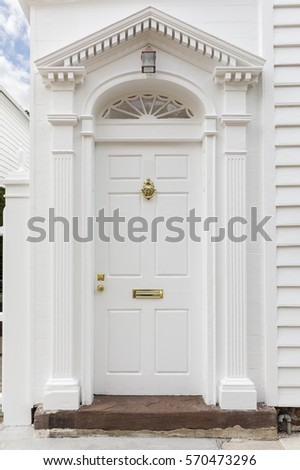 Front white door that matches the exterior