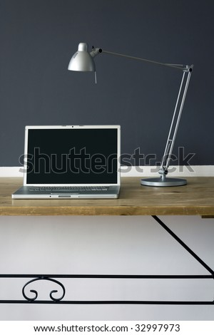 frontal Home office desk with laptop and printer