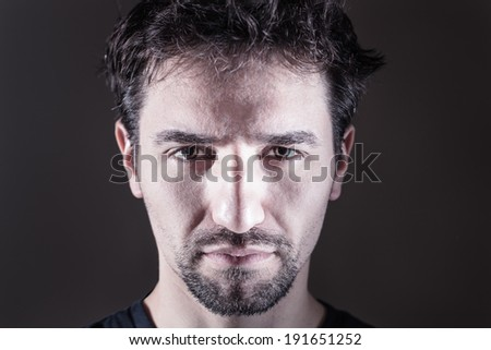 frontal portrait of young man in cold tone - stock photo