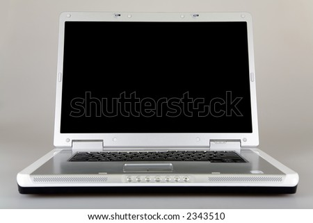 Frontal view of a laptop computer with plenty of space for text on the screen. - stock photo