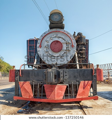 Frontal view of an old steam train