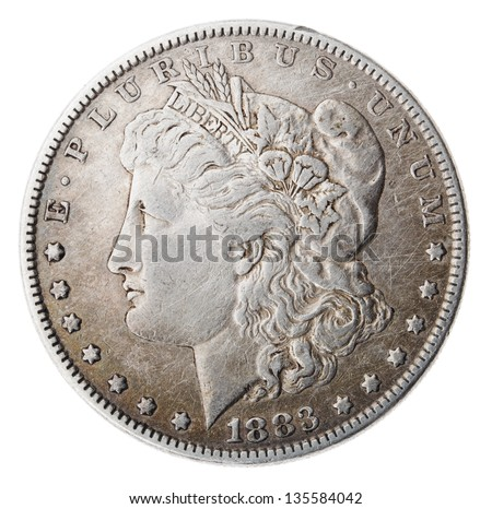 Frontal view of the obverse (heads) side of a silver dollar minted in 1883, known by the name 'Morgan Dollar'. Depicted is a profile portrait representing liberty. Isolated on white background.