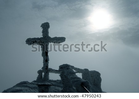 frost bound top cross on mount and sunshine