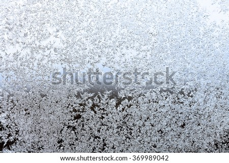 frost on window pane in cold winter evening - stock photo
