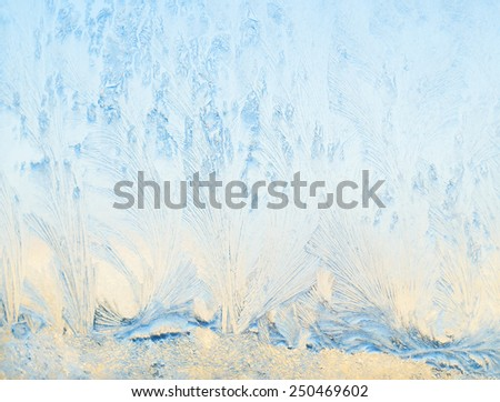 Frost patterns on glass. Ice on a window, background - stock photo