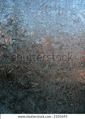 Frost patterns on window. - stock photo