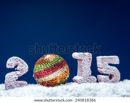 Frosted 2015 New Year digits and glistering ball over dark blue background - stock photo