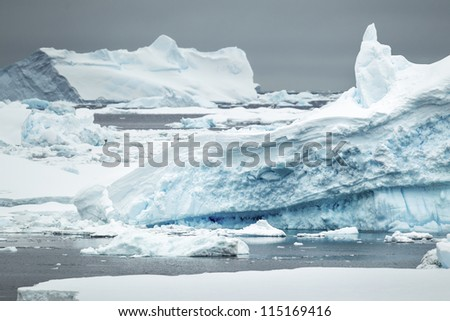 Frosting iceberg in the Antarctic ocean - stock photo