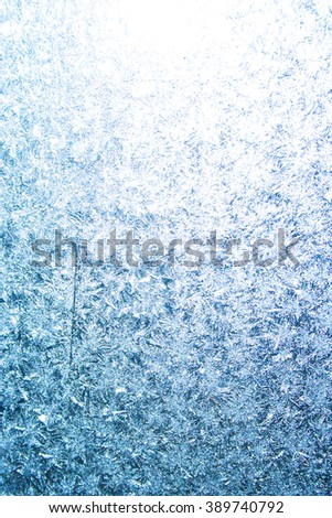 Frostwork on frozen window glass. Abstract winter background - stock photo