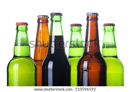 Frosty bottles of beer isolated on a white background - stock photo