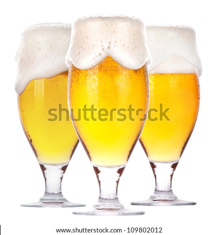 Frosty glass of beer isolated on a white background. - stock photo
