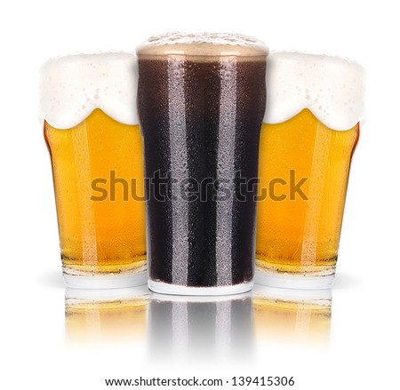 Frosty glass of dark  and light beer set isolated on a white background