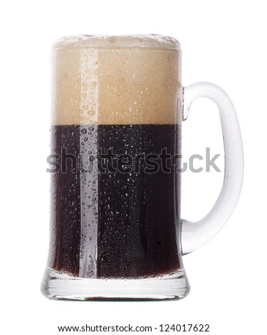Frosty glass of dark beer isolated on a white background - stock photo