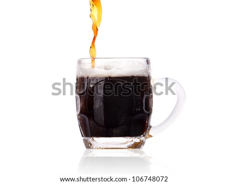 Frosty glass of dark beer with foam and water drops isolated on a white background - stock photo