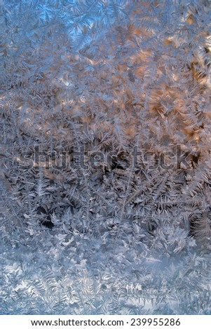 Frosty natural pattern and sunlight on winter window - stock photo