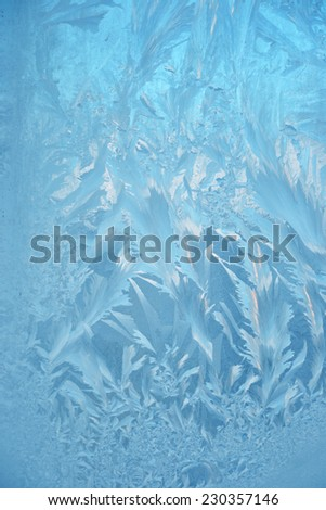 Frosty pattern at a winter window glass  - stock photo