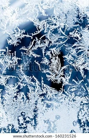 Frosty pattern on glass - stock photo