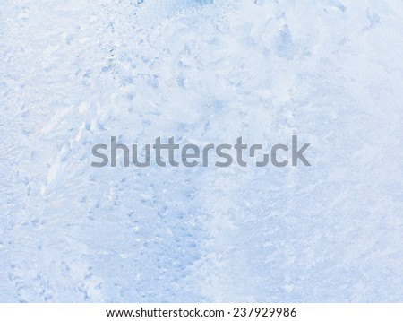 Frosty pattern on winter window, can be used as a background.  - stock photo