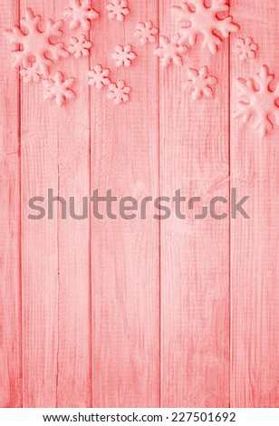 Frosty Snowflake shapes on Rustic Wood Board Background with empty room or space for copy, text, your words. Verticall faded, soft red - stock photo