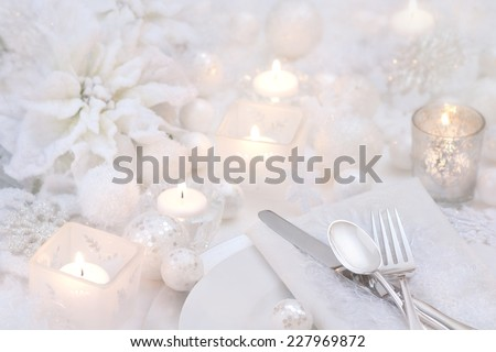 Frosty White Christmas Table Place Setting with Poinsettia, Candles, Snowballs and Snowflakes with room or space for copy, text, your words.  Horizontal, mono-tone - stock photo
