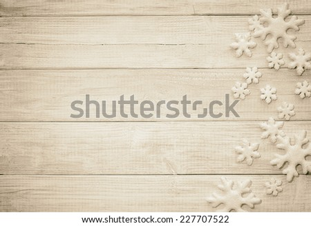 FrostySnowflake Ornaments on Rustic Wood Board Background with empty room or space for copy, text, your words. Horizontal sepia vintage, old-fashion tone - stock photo