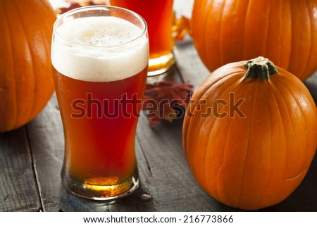 Frothy Orange Pumpkin Ale Ready to Drink - stock photo