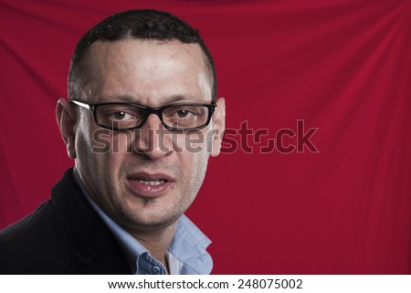 Frowning man closeup portrait on red - stock photo