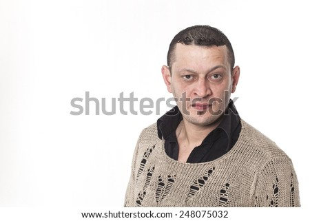 Frowning man portrait looking at camera  - stock photo