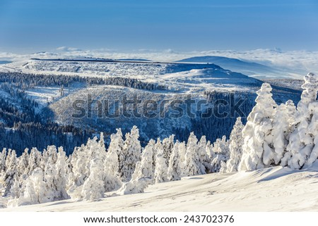 Frozen and snow covered mountains in winter Alps Austria - stock photo